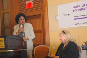 Hon. Diane Watson in conversation with Commissioner Diane Miller